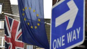 A British Union flag and a European Union flag hang from a building behind a traffic sign in central London, Britain February 17, 2016. European Union governments haggled over reform proposals on Wednesday, with pressure mounting on leaders to close remaining gaps and produce a summit deal on Friday that can help keep Britain in the EU.   REUTERS/Toby Melville